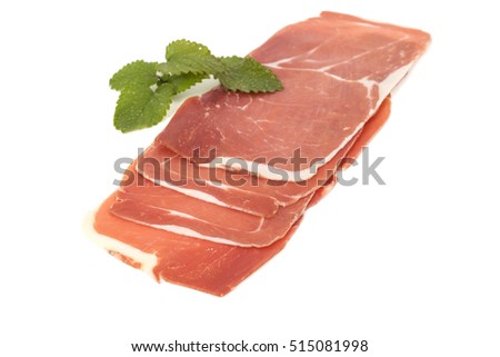 closeup on a piece of spanish serrano ham, isolated on white