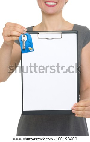Closeup on blank clipboard and keys holding by happy female realtor. HQ photo. Not oversharpened. Not oversaturated
