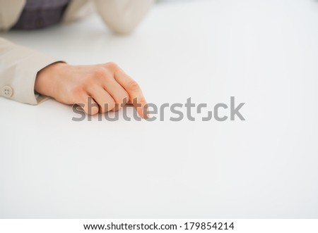 Closeup on business woman pointing on desk