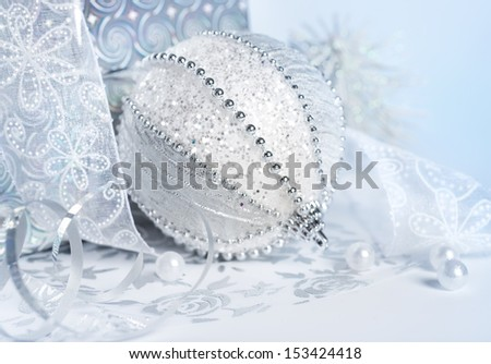 Closeup on Christmas decorations in silver and white - stock photo