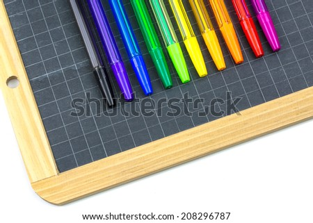 Closeup on colorful school supplies, pens and slate