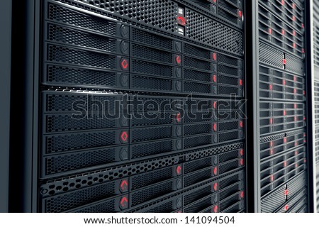 Closeup on data servers while working. Red LED lights are flashing. Image can represent cloud computing, information storage, etc. or can be the perfect technology background. - stock photo
