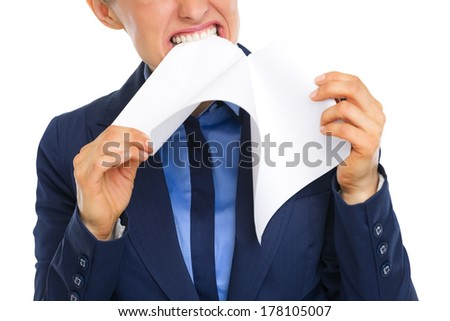 Closeup on displeased business woman tearing documents
