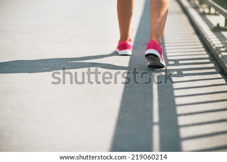 Closeup on fitness young woman walking in the city - stock photo