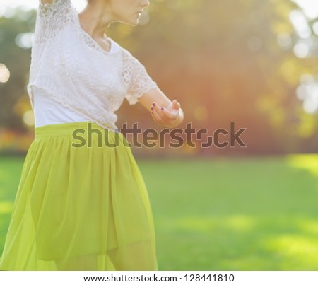 Closeup on girl dancing on meadow