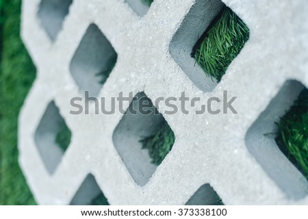 Closeup on green plants growing between concrete pavement, background - stock photo
