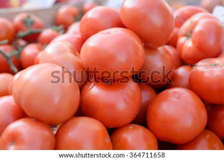 Closeup on heap of tomatoes - stock photo