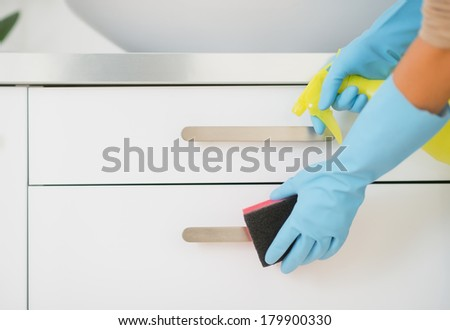 Closeup on housewife cleaning in bathroom - stock photo