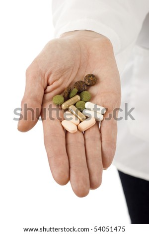 Closeup on medical doctor's hand with pills,  isolated over white background - stock photo