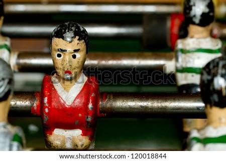 Closeup on miniature metallic ball players of a Foosball table soccer game - stock photo
