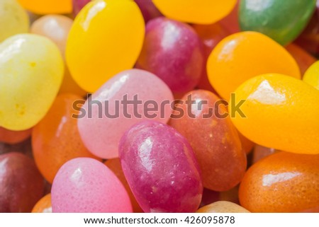 Closeup on mix of jelly beans, colorful background. Macro image, shallow depth of field - stock photo