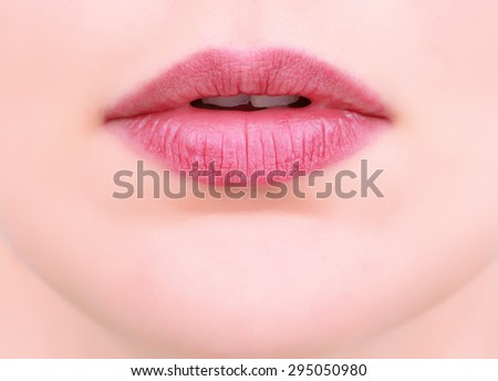 Closeup on mouth of females face - stock photo