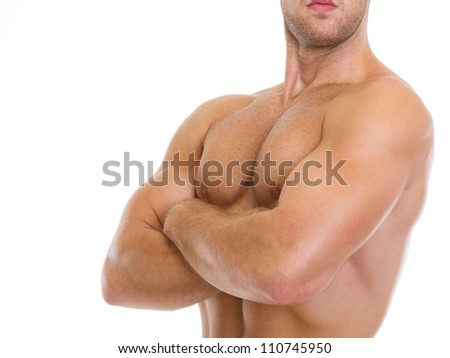 Closeup on muscular man showing chest muscles - stock photo