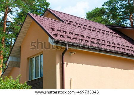 Closeup On New Rain Gutter System And Roof Protection From Snow Board (Snow  Guard)