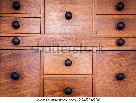 Closeup on old vintage wooden drawers - stock photo