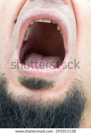 [Image: stock-photo-closeup-on-opened-mouth-of-m...051538.jpg]
