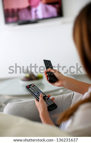 Closeup on remote control held by woman