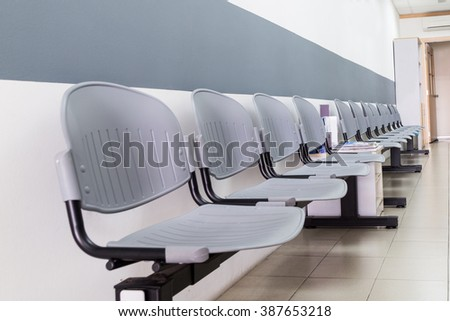 Closeup On Row Of Empty Chairs At The Reception Waiting Area Of An Interior  Office Building