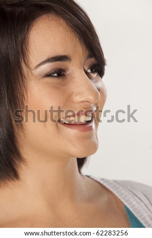 Closeup on smiling young girl on white background. - stock photo