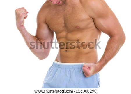 Closeup on sports man showing muscles of torso and biceps