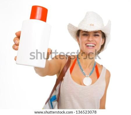 Closeup on sun screen creme in hand of beach young woman - stock photo