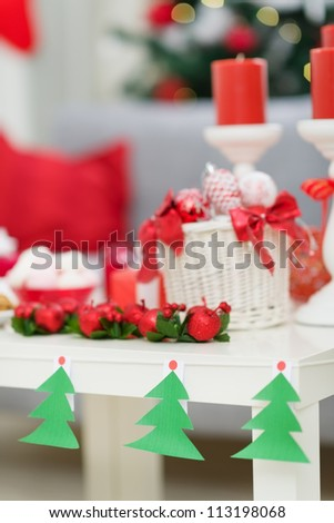 Closeup on table with Christmas decorations - stock photo