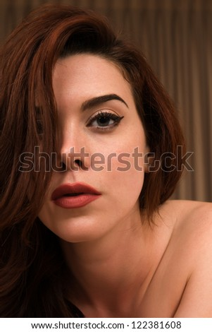 Closeup on the face of a young redhead - stock photo