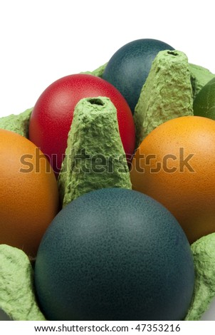 Closeup on the Group of Colored Easter eggs in the Green Egg Carrier - stock photo