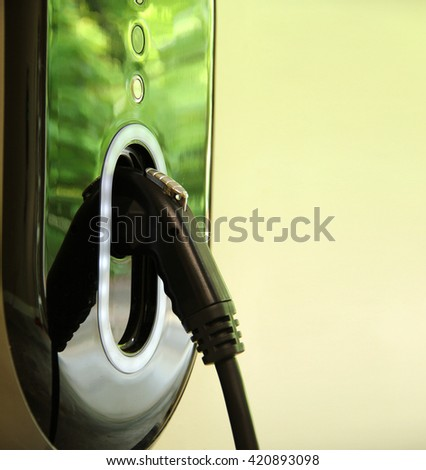 Closeup on the handle of an electric car charging plug handle.