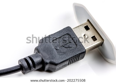 Closeup on USB cable, isolated on white - stock photo