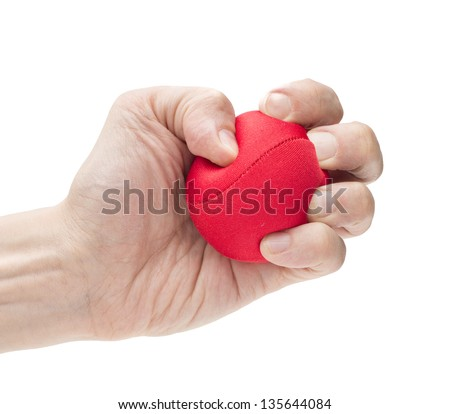 Closeup on white background of male hand with tight strong grip applying pressure on red ball - stock photo