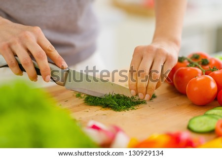 Closeup on woman cutting fresh dill