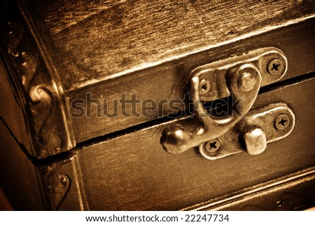 Closeup on wooden vintage chest - stock photo