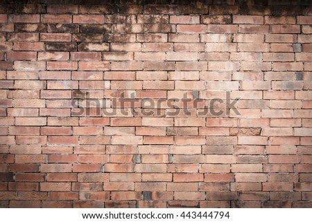 Closeup orange brick wall texture for background. Grunge retro vintage of brick wall. Part of old brick wall for design with copy space for text or image. Dark edged. - stock photo