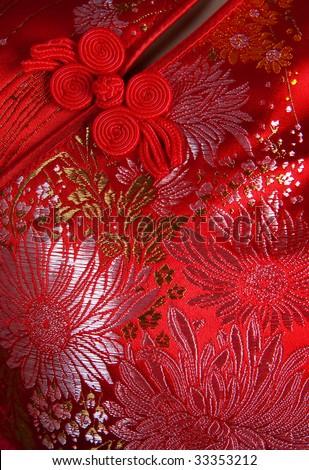 Closeup oriental cheongsam, focus on the button. - stock photo