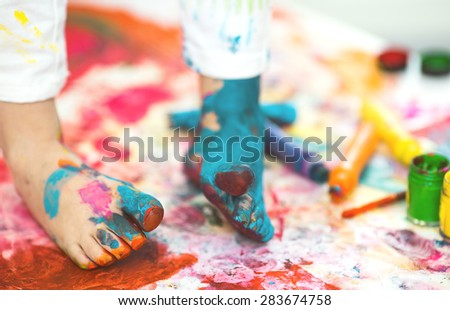 closeup painted in bright colors feet - stock photo