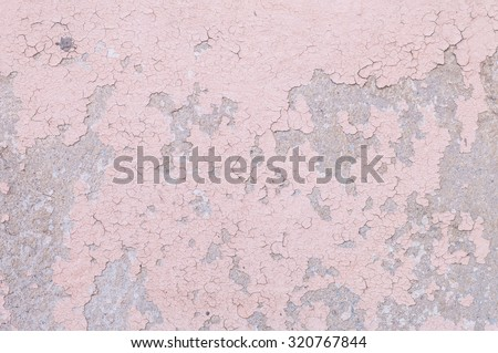 Closeup pale color and peeling of painted pink cement wall texture background - stock photo