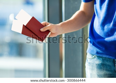 Closeup passports and boarding pass at airport indoor background airplane - stock photo