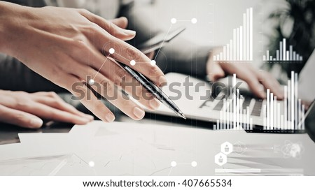 Closeup photo female hands with pen.Businessmans crew working bank investment project modern office.Using contemporary laptop.Worldwide connection technology icons,stock exchanges graphics interface.  - stock photo