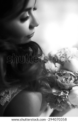 closeup photo gorgeous young brunette bride who is holding a bouquet of beautiful flowers - stock photo