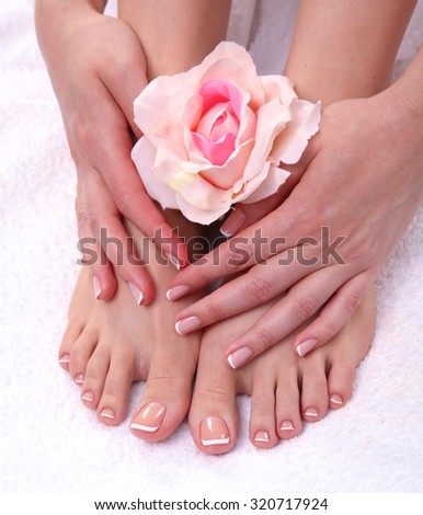 Closeup photo of a beautiful female feet with red pedicure isolated on white - stock photo