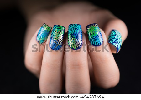 Closeup photo of a beautiful female hands with beautiful manicure - stock photo