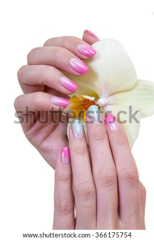 Closeup photo of a beautiful female hands with multicolored manicure and Orchid isolated on white background  - stock photo
