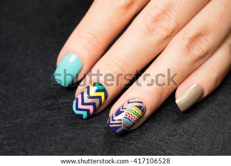Closeup photo of a beautiful female hands with nails - stock photo