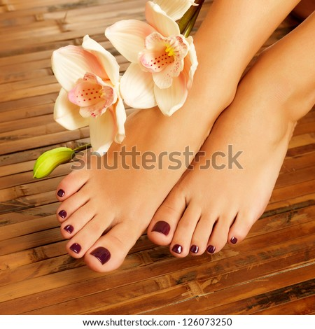 Closeup photo of a female feet at spa salon on pedicure procedure - Soft focus image - stock photo