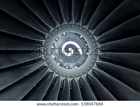 Closeup photo of a jet engine with rotation signal - stock photo