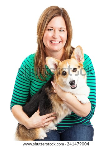 Closeup photo of a lady holding a Pembroke Welsh Corgi dog