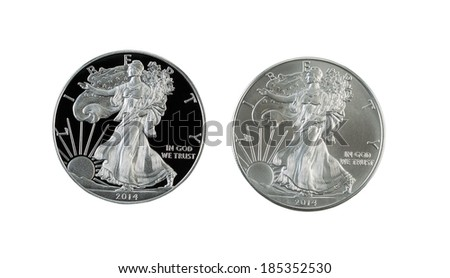 Closeup photo of a proof and uncirculated American Silver Eagle Dollar Coins side by side isolated on white