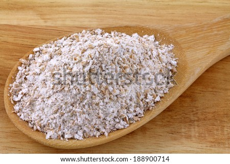 Closeup photo of a spoon of whole-grain wheat flour (Multi grain)  - stock photo