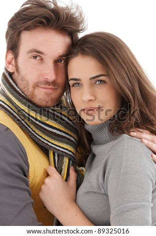 Closeup photo of attractive young loving couple, smiling, looking away.? - stock photo